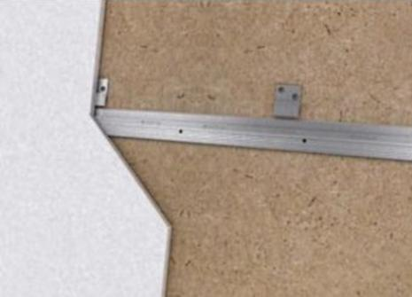Z-clips inserted on back of wall panel